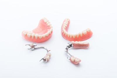 How Does A Denture Stay In Place?